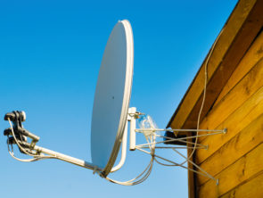 satellite antenna on a wooden house outdoors