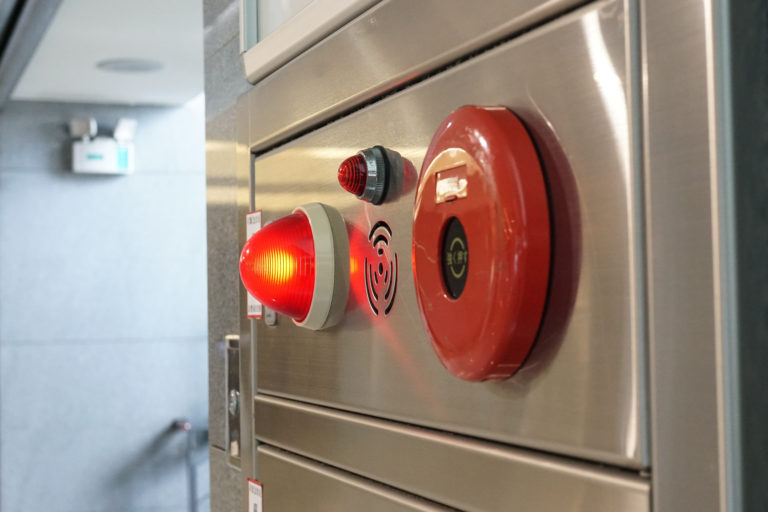 Alarm bells and warning lights for avoiding fire. Symbolizes fire, safety, and crime.
