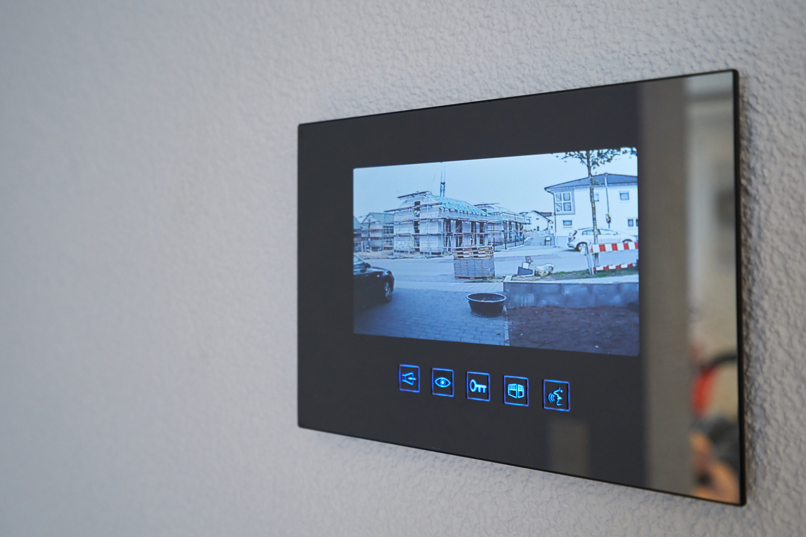 Intercom with video image mounted on the wall in the house.