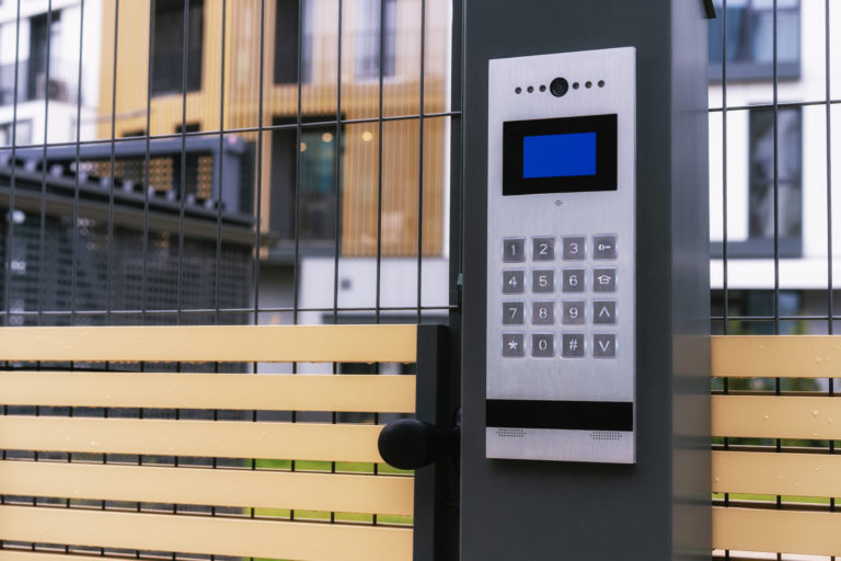 safety in modern residential buildings. fenced yard, closed gate with electronic lock