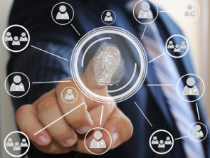 Businessman pressing modern technology with a fingerprint reader on a virtual screen. Electronic security system, access via the fingerprint reader